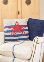 Design: Stardust and Emblem cushion